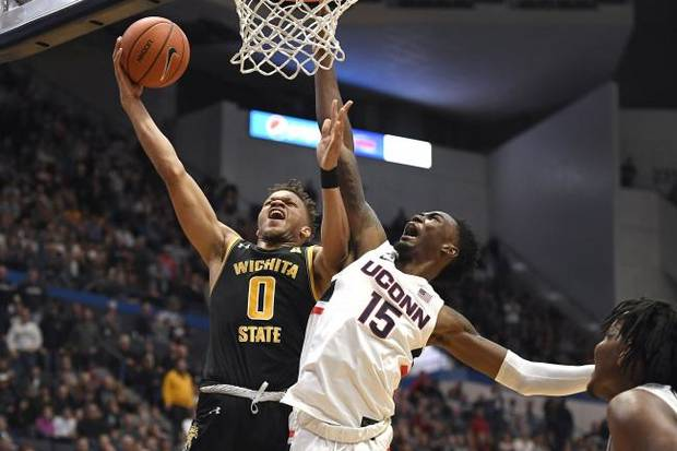 College Basketball Roundup: Shockers hold off UConn in overtime