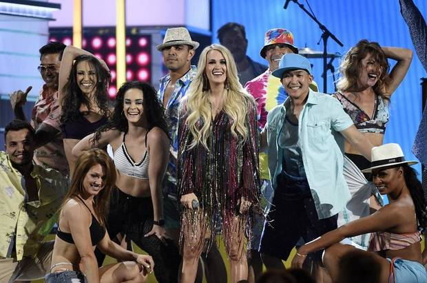 "Carrie Underwood, center, performs ""Southbound"" at the 54th annual Academy of Country Music Awards at the MGM Grand Garden Arena on Sunday, April 7, 2019, in Las Vegas. (Photo by Chris Pizzello/Invision/AP)"