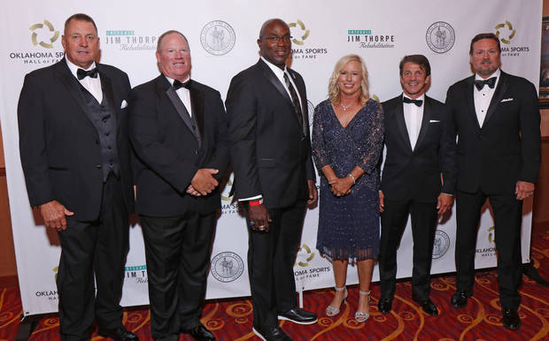 Mike Moore (from left), Mickey Tettleton, Will Shields, Patty Gasso, Kendall Cross and Bob Stoops pose before the Oklahoma Sports Hall of Fame ceremony Monday night in Norman. (Photo by Doug Hoke)