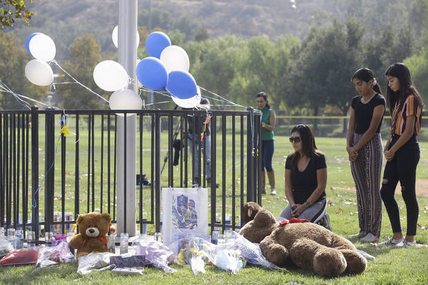 California school shooter dies with motive a mystery