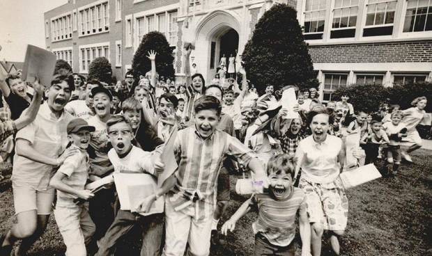 On May 27, 1965, children scramble at full speed out the doors of Edgemere Elementary School and into summer, embracing the end of school with obvious enthusiasm. It was the last day of school for 75,000 Oklahoma City schoolchildren. This year, Oklahoma City Public Schools' last day of classes will be Tuesday. [PHOTO BY JIM LUCAS, THE OKLAHOMAN ARCHIVES]