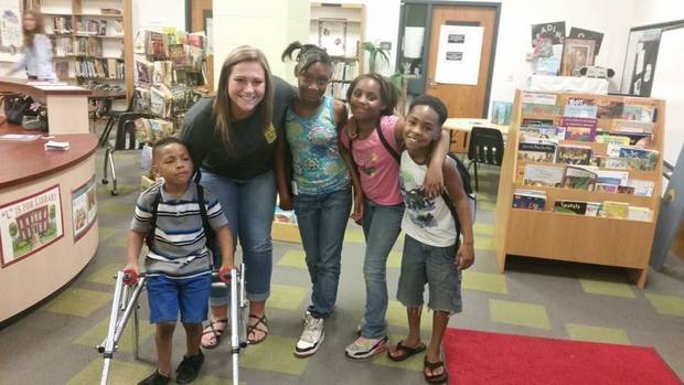 TEACH club President, Lindsey Johnson with some students from OKCPS who were recipients of a backpack drive she headed up to provide 245 students with a backpack and school supplies.