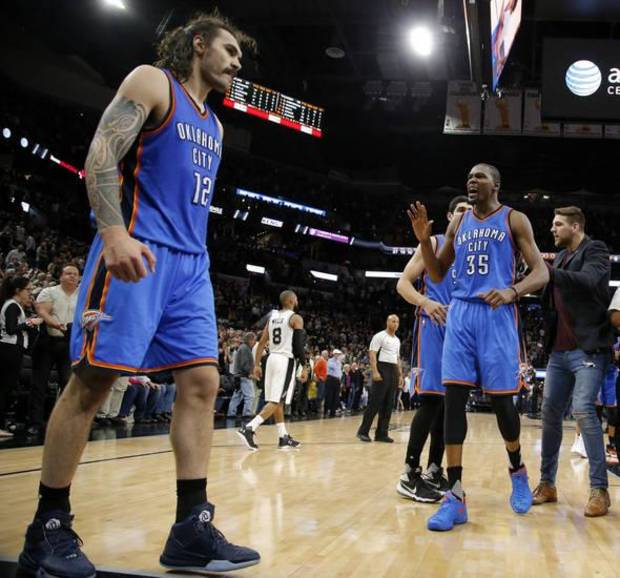 Oklahoma City's Kevin Durant (35) celebrates as he walks towards Steven Adams (12) after winning Game 2 of the second-round series between the Oklahoma City Thunder and the San Antonio Spurs in the NBA playoffs at the AT&T Center in San Antonio, Monday, May 2, 2016. Oklahoma City won 98-97. Photo by Bryan Terry, The Oklahoman