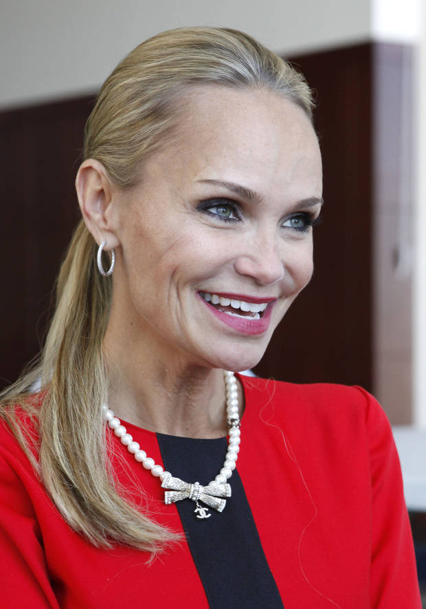 Actress Kristin Chenoweth speaks with Oklahoman writer Silas Allen before receiving an honorary PhD. from Oklahoma City University in Oklahoma City, OK, Saturday, May 11, 2013,  By Paul Hellstern, The Oklahoman