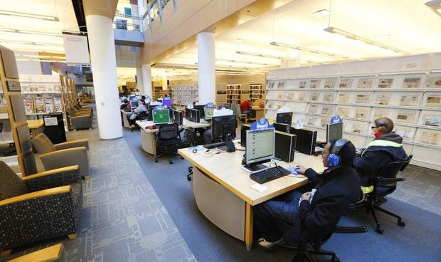 People work on computers in the Ronald J. Norick Downtown Library Friday, March 21, 2014. [The Oklahoman Archives]