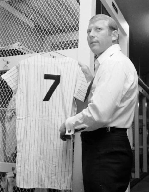 New York Yankees Mickey Mantle hangs up his jersey in the Yankee Stadium dressing room in New York in this June 8, 1969, photo. AP Photo