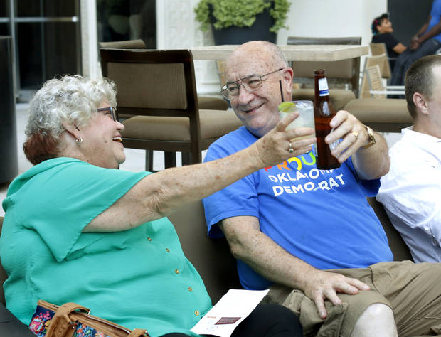 Ron Marlatt and his wife, Liz, toast beverages after early voting results indicated a lead for the approval of SQ 788, the medical marijuana issue. The Marletts, who live in Warr Acres, attended a watch party at the Colcord Hotel in downtown Oklahoma City where a small group of medical marijuana supporters followed election results on television and electronic devices. Photo by Jim Beckel, The Oklahoman