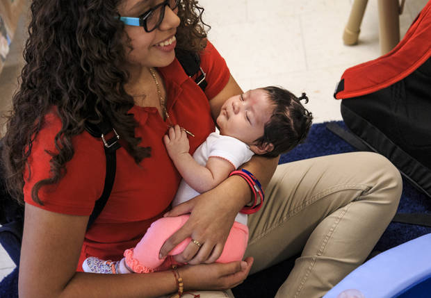 High School student Sayra Perez holds her baby Zeleyna Lopez while in the new US Grant High School daycare center in Oklahoma City, Okla. on Thursday, Aug. 16, 2018. Photo by Chris Landsberger, The Oklahoman