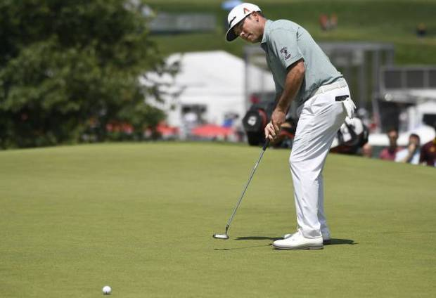 Golf Roundup: Reavie holds off Bradley, Sucher for first win in 11 years