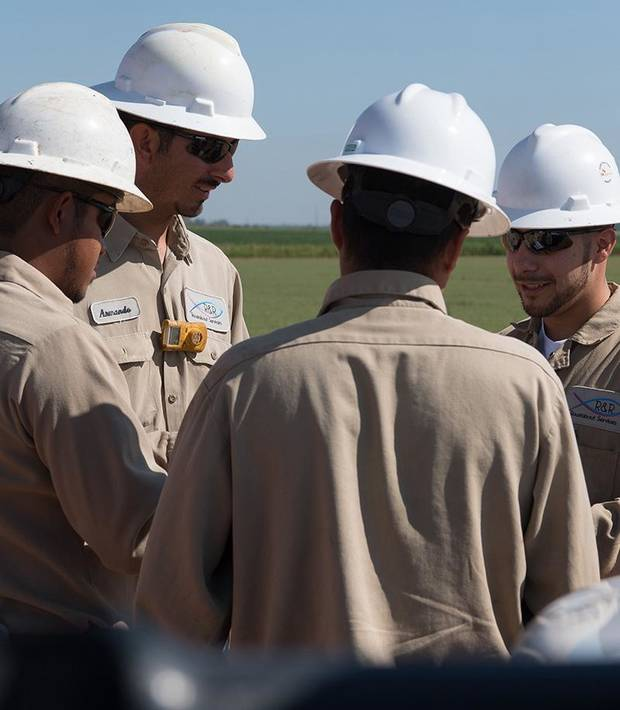 Melendez out in the field with his team. Photo provided by EnergyHQ.