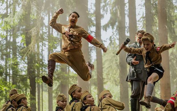 "Taika Waititi, left, and Roman Griffin Davis star in the World War II satire ""Jojo Rabbit."" [Fox Searchlight Pictures]"