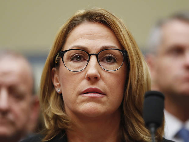 Mylan CEO Heather Bresch testifies on Capitol Hill in Washington, Wednesday, Sept. 21, 2016, before the House Oversight Committee hearing on EpiPen price increases. Bresch defended the cost for life-saving EpiPens, signaling the company has no plans to lower prices despite a public outcry and questions from skeptical lawmakers. (AP Photo/Pablo Martinez Monsivais)