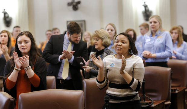 College students stand to applaud a student speaker during 2018 Higher Education Day activities Feb. 13 at the state Capitol.[ Photo by Jim Beckel, The Oklahoman]