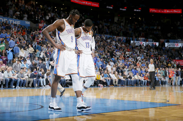 Oklahoma City's Jerami Grant (9) and Paul George (13) walk toward the bench after a timeout during an NBA basketball game between the Oklahoma City Thunder and the Miami Heat at Chesapeake Energy Arena in Oklahoma City, Monday, March 18, 2019. Miami won 116-107. Photo by Bryan Terry, The Oklahoman