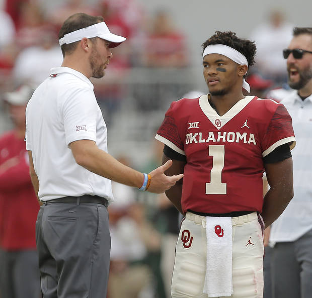 Oklahoma's Kyler Murray (1) talks with coach Lincoln Riley during a college football game between the University of Oklahoma Sooners (OU) and the Baylor Bears at Gaylord Family-Oklahoma Memorial Stadium in Norman, Okla., Saturday, Sept. 29, 2018. Oklahoma won 66-33. Photo by Bryan Terry, The Oklahoman