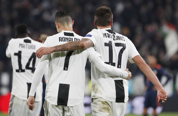 cb26e8c530 TURIN, Italy (AP) — Cristiano Ronaldo set up Mario Mandzukic for the  winning goal as Juventus secured a spot in Champions League knockout stage  with a 1-0 ...