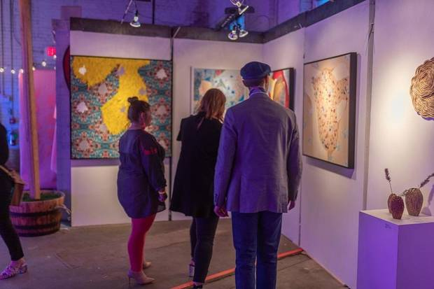 "Viewers look at art at the Oklahoma Visual Arts Coalition's ""Momentum 2019."" [Photo provided]"