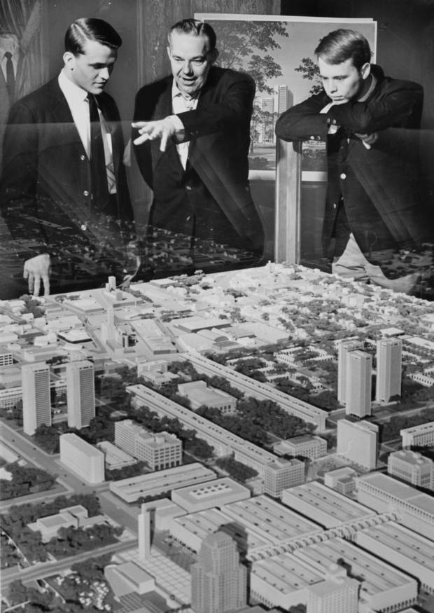 I.M. PEI: Taking a peek at a model of the Pei Plan for downtown are two Sooner World's Fair Guides, in Oklahoma City for a special tour. Jim Yielding, urban renewal authority director, center, points out features of plan to Robert Gibson, left, and Tom Dobson. Thirty-four Sooner guides took the city tour. Staff photo by Bob Albright, dated March 13, 1966. Original from Oklahoman print archive, copied Friday, April 30, 2010. Copy photo by Doug Hoke, The Oklahoman. ORG XMIT: KOD