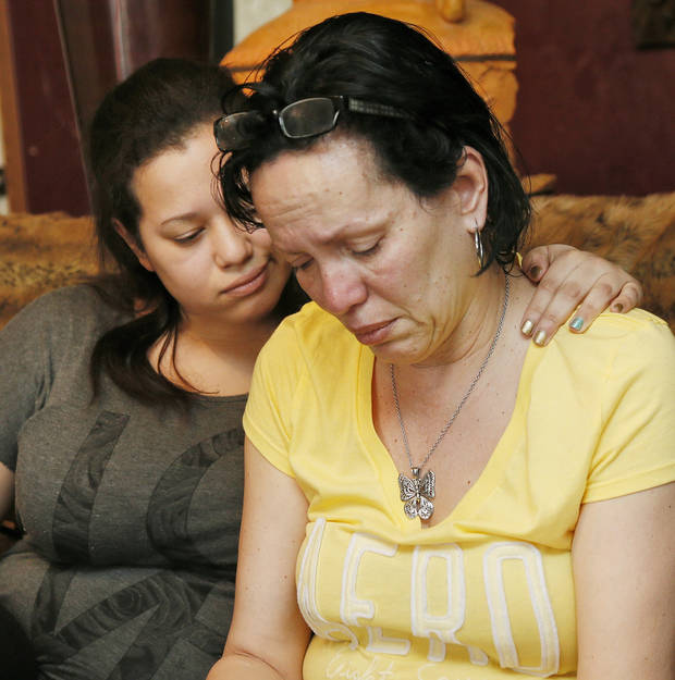 Nair Rodriguez, right, and her daughter Luinahi Rodriguez comfort each other during an interview about the death of husband and father Luis Rodriguez during an incident with Moore police at the Warren Theatre, Friday, Feb. 14, 2014. The pair are shown at the Rodriguez family's home in Norman, Okla., Monday, Feb. 17, 2014. Photo by Nate Billings, The Oklahoman
