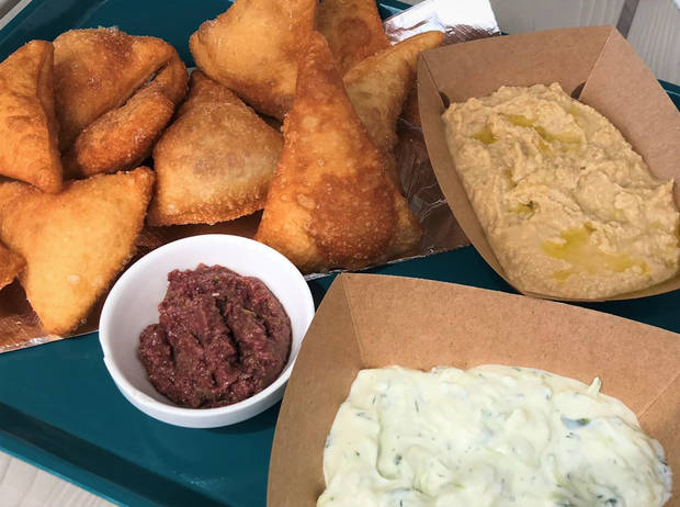 The Spread included fry bread, olive tapeniade, tzatziki, and Mrs. Moses Lebanese Hummos at Lua Mediterranean in The Plaza District. [Dave Cathey/The Oklahoman]