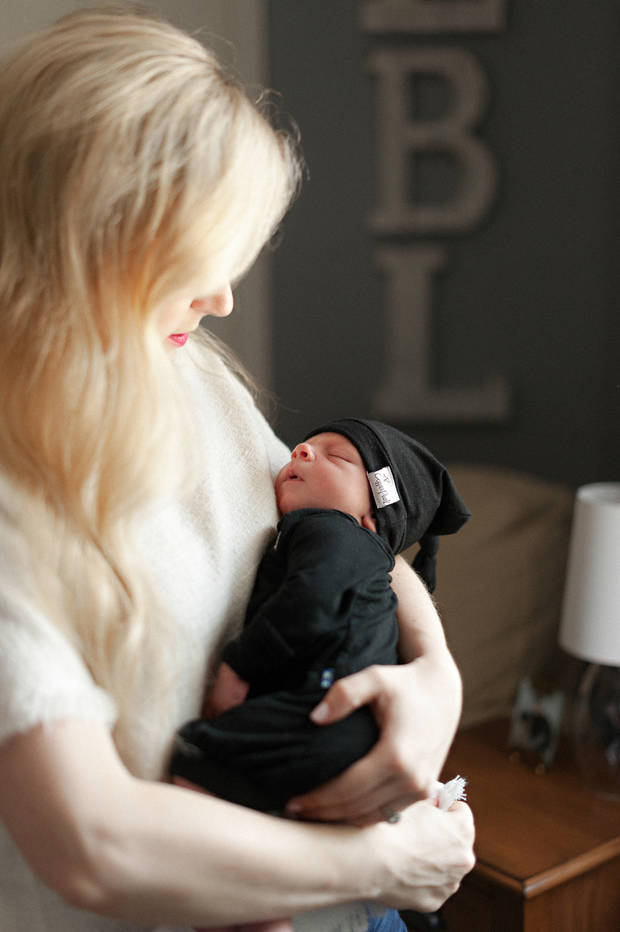 Pharmacist Courtney Lundeen with her newborn. (Photo by Caroline Eidson Photography)