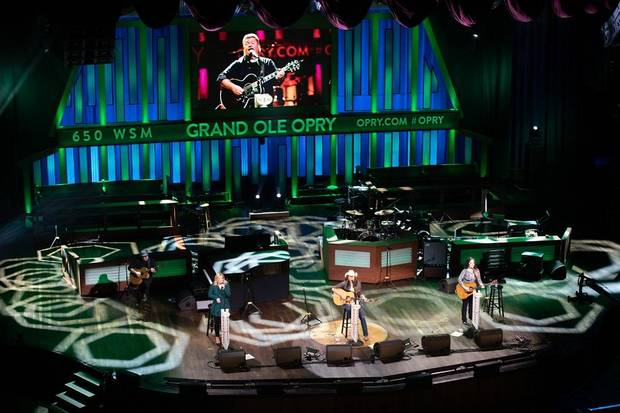 "From left, Lauren Alaina, Terri Clark and Ashley McBryde honored Opry member Joe Diffie with a performance of one of Diffie's many hits, ""John Deere Green,"" on the Grand Ole Opry Saturday night in Nashville, Tennessee. [Chris Hollo/Grand Ole Opry]"
