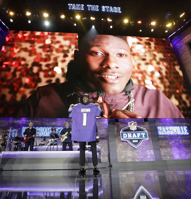 Oklahoma wide receiver Marquise Brown poses with his new jersey after the Baltimore Ravens Brown selected in the first round at the NFL football draft, Thursday, April 25, 2019, in Nashville, Tenn.(AP Photo/Mark Humphrey)