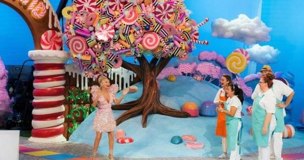 "From left, ""Candy Land"" host Kristin Chenoweth speakes with contestants Cinthya Romriell, Eric Kroeker, Brittani Diehl and Reva Alexander-Hawk on an episode of the first season of the new Food Network competition series based on the classic board game. ""Candy Land"" premieres at 8 p.m. Nov. 15. [Food Network photo]"