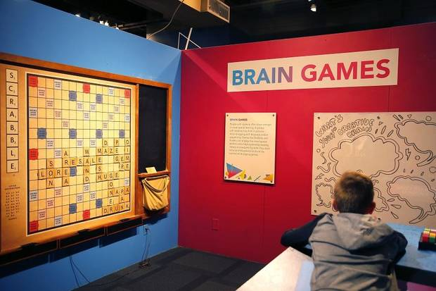 "A child stands inside the exhibit ""Beautiful Minds: Dyslexia and the Creative Advantage"" at Science Museum Oklahoma in Oklahoma City, Thursday, March 21, 2019. [Bryan Terry/The Oklahoman]"