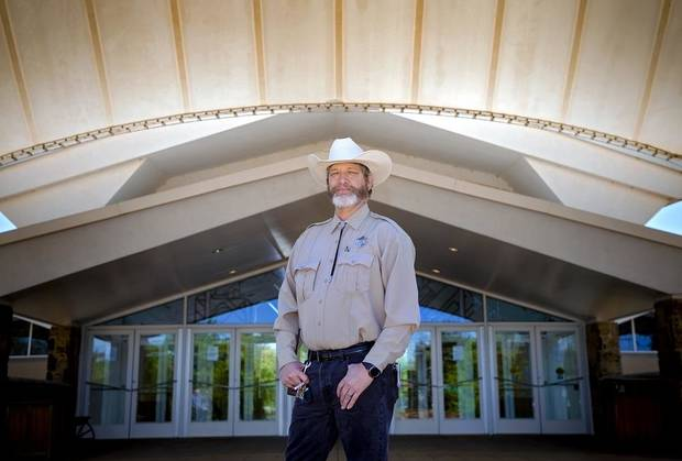 Tim Tiller, National Cowboy & Western Heritage Museum's head of security, poses for a photo outside the museum in Oklahoma City, Okla. on Wednesday, April 15, 2020. Tiller's takeover of the museum's social media during its spring closure due to the coronavirus earned him global social media attention. [Chris Landsberger/The Oklahoman Archives]