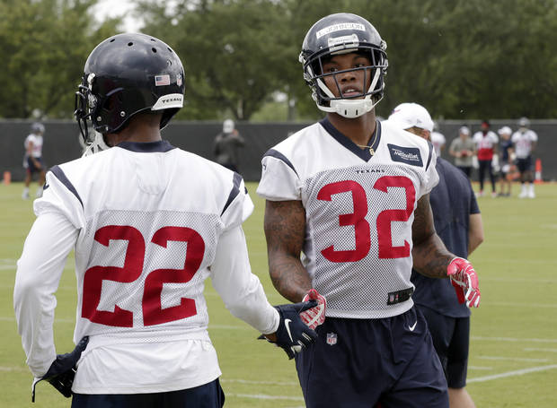 Houston Texans rookie cornerback Lonnie Johnson Jr. (32) and Aaron Colvin (22) low five during a NFL football Organized Team Activity workout Tuesday, May 21, 2019, at the team practice facilities in Houston. (AP Photo/Michael Wyke)