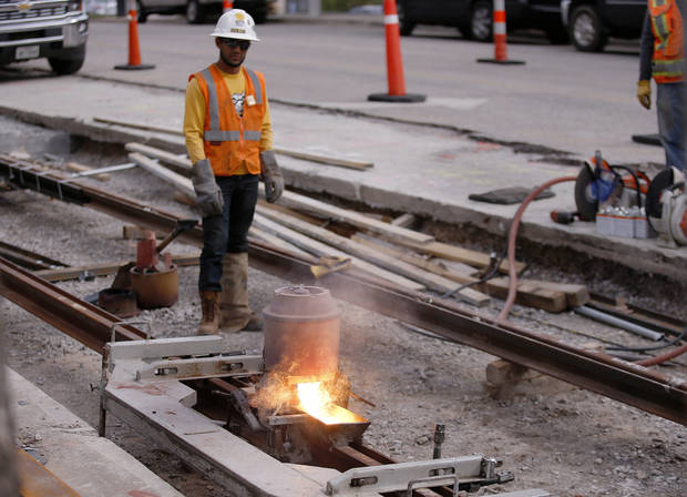 Safety was a major focus during the two years it took to complete construction of the Oklahoma City Streetcar mainline. Three minor injuries were reported. The final weld on the 904 tons of Austrian-fabricated rail was done at NW 5 and Robinson on Oct 17. [Photo by Sarah Phipps, The Oklahoman]