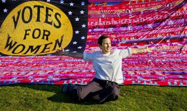 "Oklahoma artist Marilyn Artus poses for a photo with her completed multi-year ""Her Flag"" to commemorate the 19th Amendment at Scissortail Park in Oklahoma City, Okla. on Friday, Aug. 21, 2020. [Chris Landsberger/The Oklahoman Archives]"