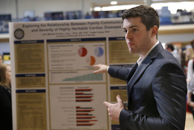 John Michael Purdon, with the University of Pittsburgh School of Nursing, discusses his research with others Thursday at the 2018 National Conference on Undergraduate Research. [Photo by Sarah Phipps, The Oklahoman]
