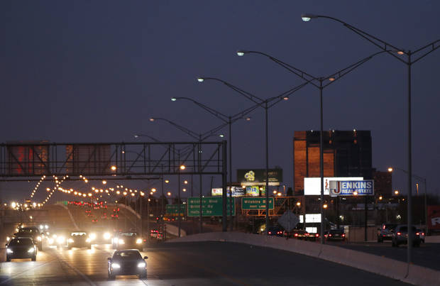 The highway lighting north of NW 63 on I-235 has been hit by thieves pulling copper wire from light poles. [Photo by Doug Hoke, The Oklahoman]