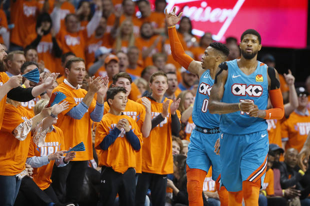 Oklahoma City's Russell Westbrook (0) gestures to the crowd beside Paul George (13) during Game 3 in the first round of the NBA playoffs between the Portland Trail Blazers and the Oklahoma City Thunder at Chesapeake Energy Arena in Oklahoma City, Friday, April 19, 2019. Oklahoma City won 120-108. Photo by Bryan Terry, The Oklahoman