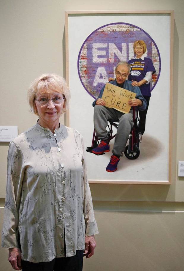 "Carol Goodwin stands in front of the portrait of her and her late husband, Mark, by Georgia-based Oklahoma native Mike Wimmer at the Oklahoma History Center, Thursday, March 21, 2019. An exhibit of Wimmer's portraits of Oklahomans titled ""Will Work For ..."" is on view through June 29 at the history Center. [Photo by Doug Hoke/The Oklahoman]"