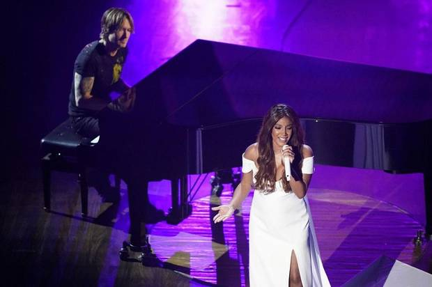 "Mickey Guyton, right, and Keith Urban perform ""What Are You Gonna Tell Her?"" during the 55th annual Academy of Country Music Awards at the Grand Ole Opry House on Wednesday, Sept. 16, 2020, in Nashville, Tenn. [AP Photo/Mark Humphrey]"