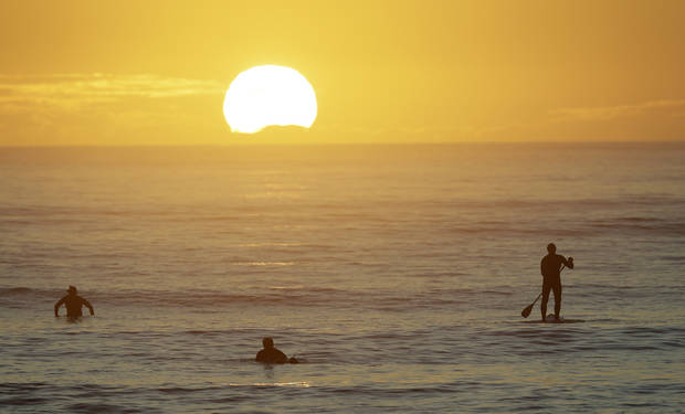 Asia Today: Surfers back in the water in New Zealand, Bondi