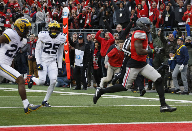 Ohio State running back Curtis Samuel scores a touchdown against Michigan during the second overtime of an NCAA college football game Saturday, Nov. 26, 2016, in Columbus, Ohio. Ohio State beat Michigan 30-27 in double overtime. (AP Photo/Jay LaPrete)