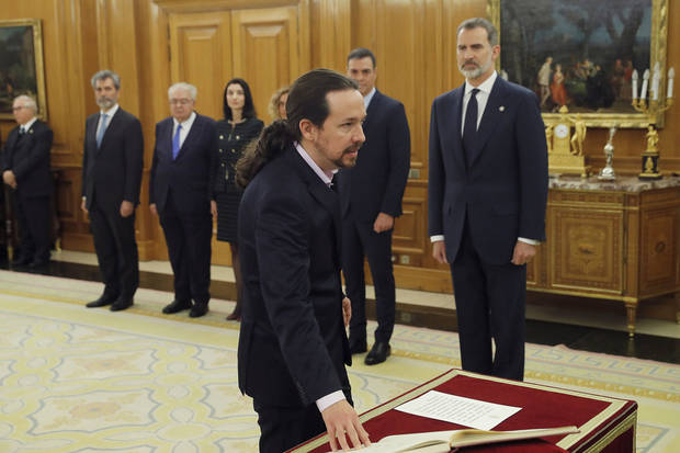 Spain's new coalition government Cabinet members take oaths