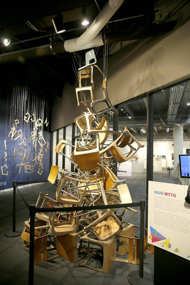 "People look at an art installation by Mark Wittig included in the exhibit ""Beautiful Minds: Dyslexia and the Creative Advantage"" inside Science Museum Oklahoma in Oklahoma City, Thursday, March 21, 2019. [Bryan Terry/The Oklahoman]"