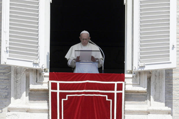 Pope Francis prays for the victims of the Kerala floods during the Angelus noon prayer in St.Peter's Square, at the Vatican, Sunday, Aug.19, 2018. (AP Photo/Gregorio Borgia)