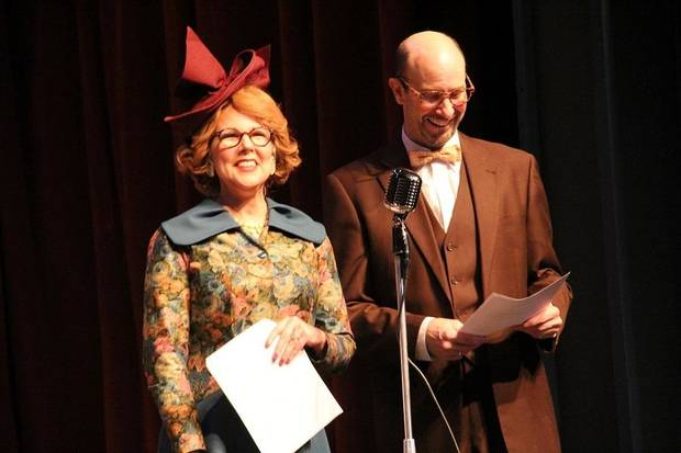 "From left, Kris Schinske and Jamie Hughes appear in The Pollard Theatre's 2018 production of ""It's a Wonderful Life: A Live Radio Play"" at the historic downtown Guthrie theater. [Photo by Jennifer Jones]"