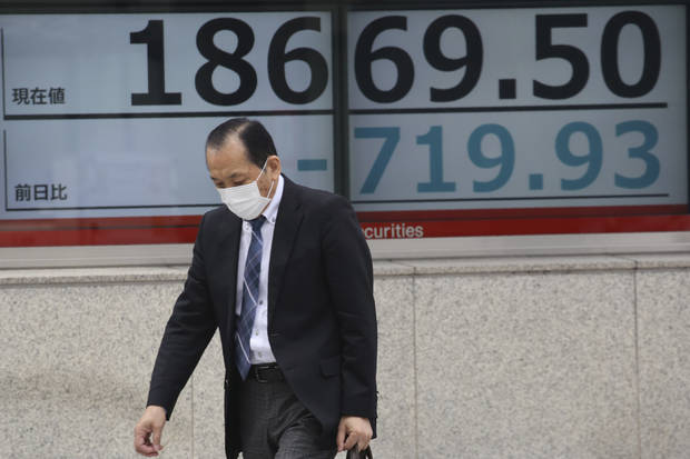 World shares extend losses as toll from pandemic surges