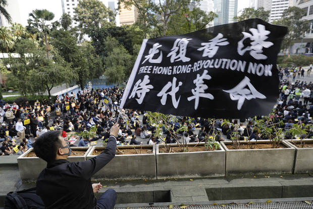 The Latest: China to suspend US Navy visits to Hong Kong