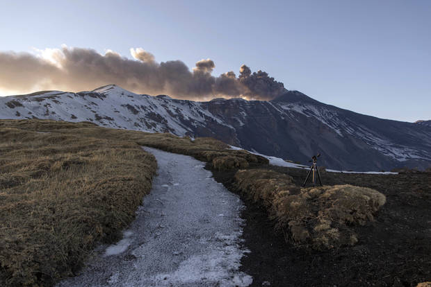 Smoke billows from the Mt. Etna's volcano, near Catania, in Sicily, southern Italy, Thursday, March 16, 2017. Volcanic rocks and steam injured at least 10 people, including tourists and a scientist, following an explosion on Sicily's Mount Etna Thursday, witnesses and media reported. (AP Photo/Salvatore Allegra)