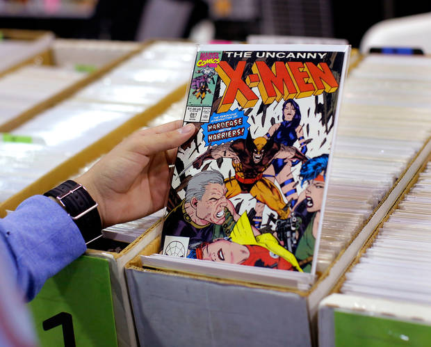 Comic books at an Oklahoma City convention. [photo by Jim Beckel, The Oklahoman]