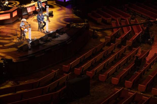 Dustin Lynch and Trace Adkins perform on the Grand Ole Orpy Saturday in Nashville, Tennessee, without an audience due to the coronavirus pandemic. [Chris Hollo/Grand Ole Opry]