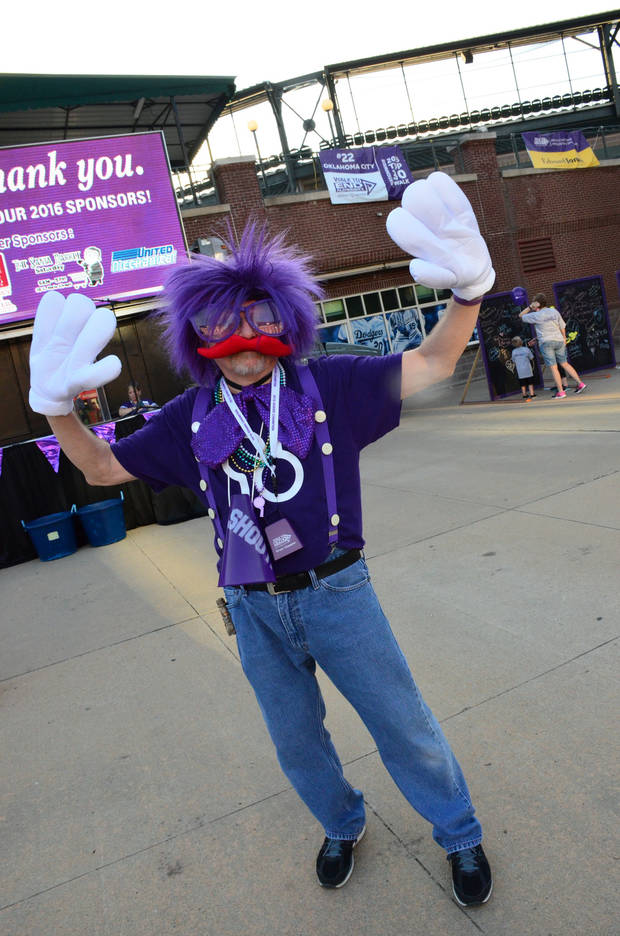 "Herb Magley as the ""Purple People Greeter"" at last year's walk. Photo provided."